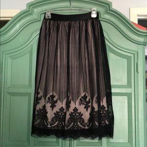 Sz XS knee length flowy skirt